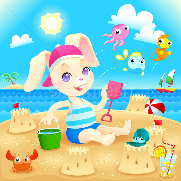 Young rabbit makes castles on the beach.  Stock photo © ddraw