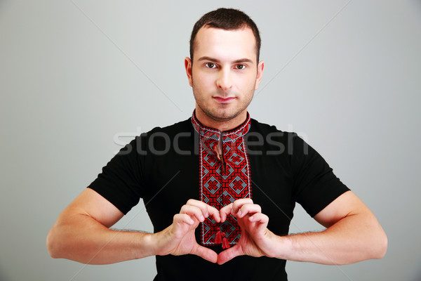 Portrait of man in the Ukrainian national clothes on gray background Stock photo © deandrobot
