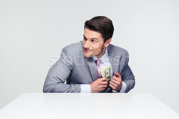бизнесмен деньги кармана серый таблице Сток-фото © deandrobot