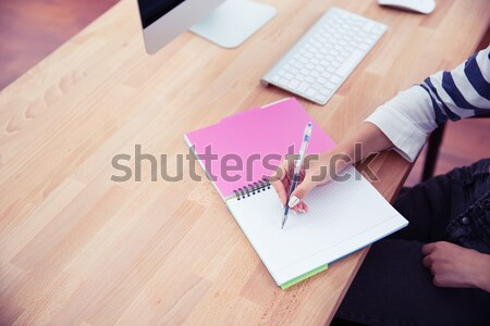 Casual woman writing notes Stock photo © deandrobot