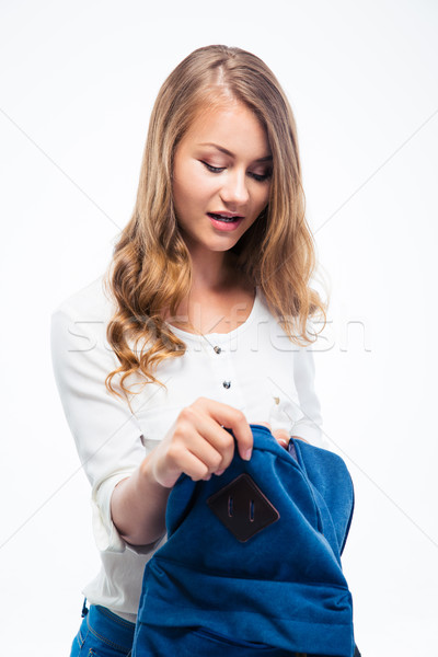 Happy girl opening her backpack Stock photo © deandrobot