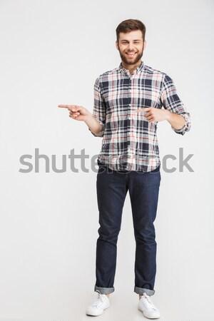 Businessman holding copyspace on the palm Stock photo © deandrobot