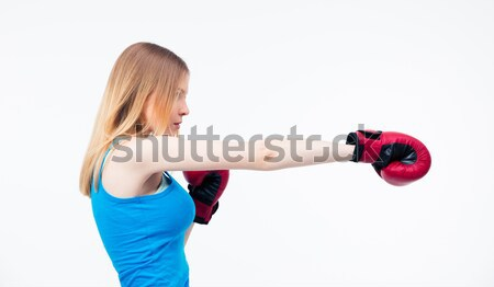 Businesswoman fighting in boxing gloves  Stock photo © deandrobot
