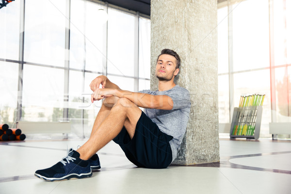 Man resting on the floor at gym Stock photo © deandrobot