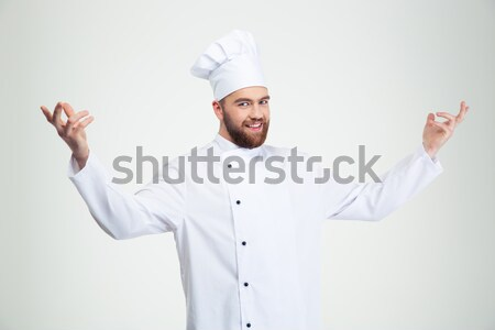 Happy chef cook showing welcome gesture Stock photo © deandrobot