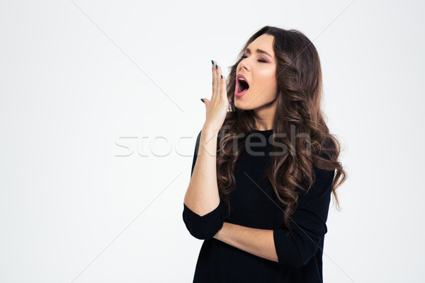 Portrait of a young girl yawning Stock photo © deandrobot