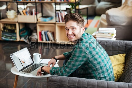Pensive guy thinking and using laptop in cafe Stock photo © deandrobot