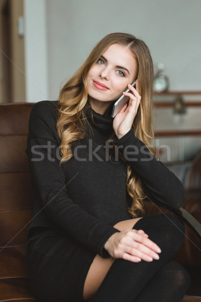 Beautiful content smiling young female talking on mobile phone  Stock photo © deandrobot