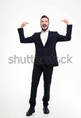 Handsome cheerful businessman in suit laughing and pointing on himself  Stock photo © deandrobot