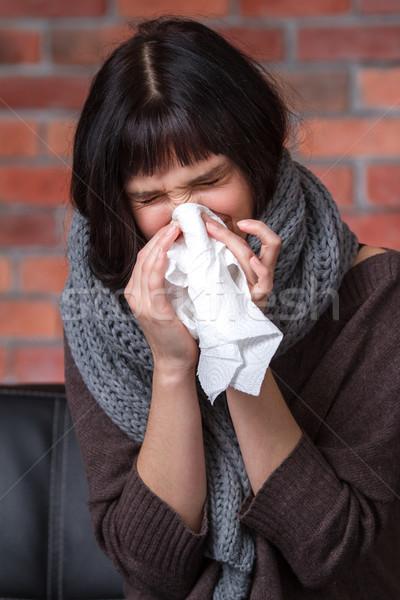 Beteg fiatal női ül kanapé zsebkendő Stock fotó © deandrobot