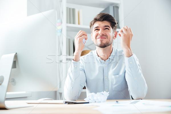 Zły zły młodych biznesmen pracy biuro Zdjęcia stock © deandrobot