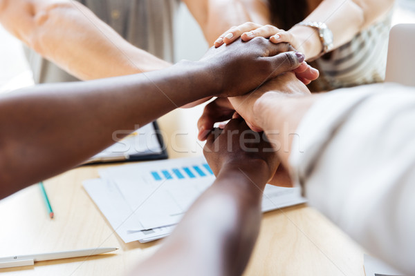 Group of business people joining hands together Stock photo © deandrobot