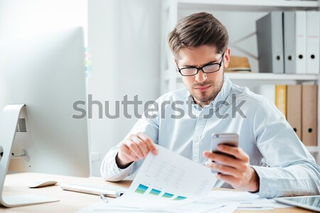 Businessman working with documents and computer in office Stock photo © deandrobot