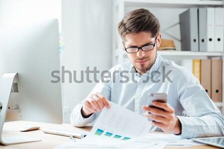 üzletember dolgozik iratok számítógép iroda jóképű Stock fotó © deandrobot