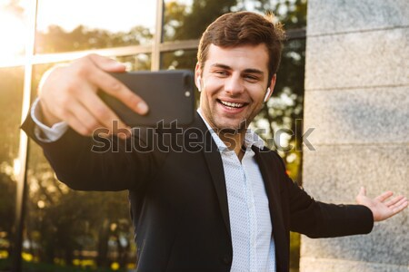 Man sitting in outdoor cafe and paying by credit card Stock photo © deandrobot