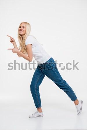 Teljes alakos portré boldog nő mutat izmok Stock fotó © deandrobot