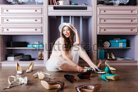 Girl choosing shoes in her wardrobe Stock photo © deandrobot