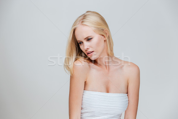 Portrait of a beautiful seductive woman wearing white top Stock photo © deandrobot