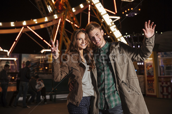 Funny couple in amusement park Stock photo © deandrobot