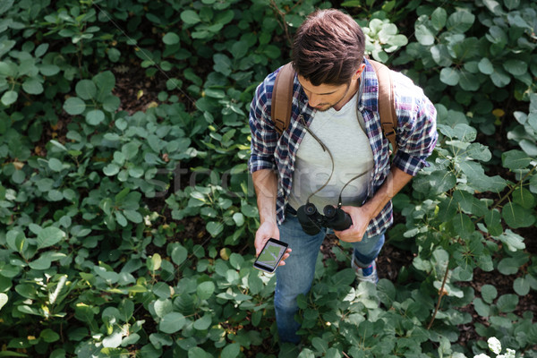 From above image of guy in forest Stock photo © deandrobot
