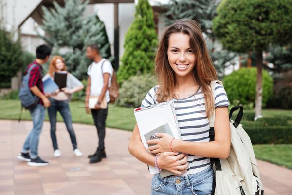 Wesoły kobieta student plecak stałego kampus Zdjęcia stock © deandrobot