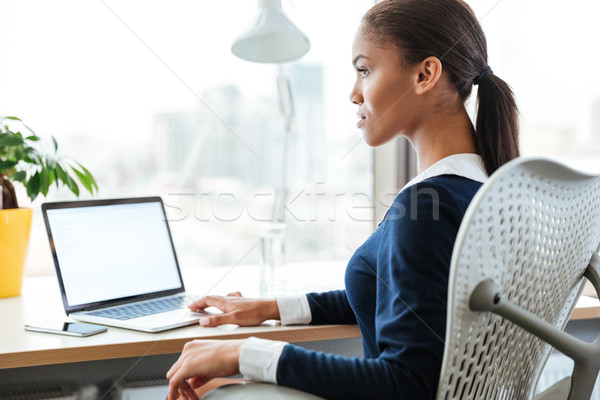 Business woman by the table Stock photo © deandrobot