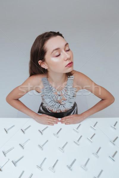 érzéki nő ül asztal klasszikus borotva Stock fotó © deandrobot
