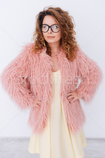 Vertical image of woman in fur coat Stock photo © deandrobot