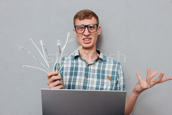 Funny student in glasses with laptop Stock photo © deandrobot