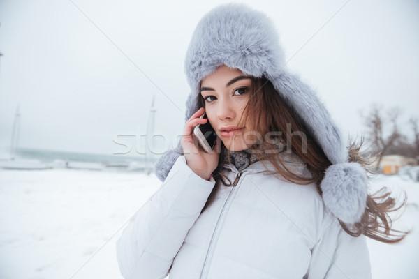 Pretty woman wearing hat walking near beach Stock photo © deandrobot