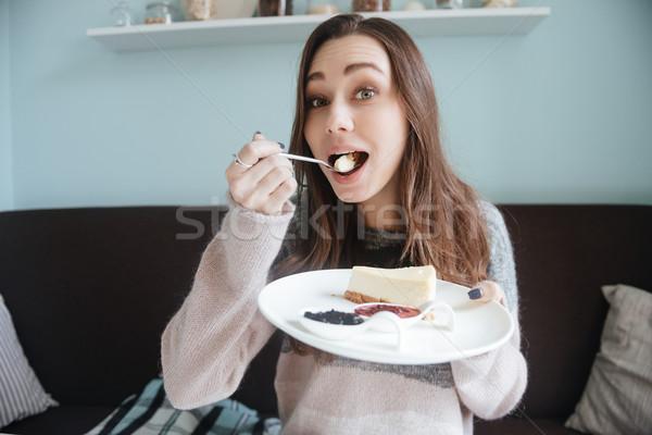 счастливым сидят кафе еды торт Сток-фото © deandrobot