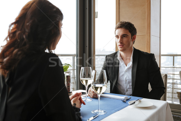 Photo from back of woman with man in restaurant Stock photo © deandrobot