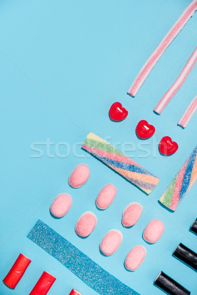 Top view of a group of colorful tasty sweet candies Stock photo © deandrobot