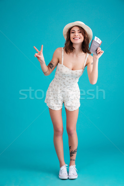 Stock photo: Full length portrait of a happy satisfied young traveller woman