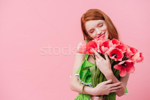 Boldog gyömbér nő tart virágcsokor virágok Stock fotó © deandrobot