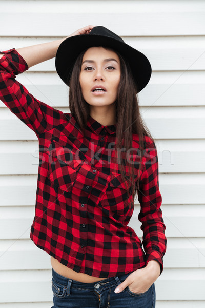 Serious young caucasian lady walking outdoors Stock photo © deandrobot