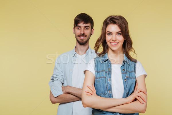 Feliz irmão irmã amarelo imagem olhando Foto stock © deandrobot