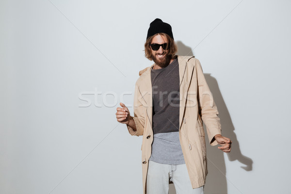 Bearded hipster cheerful man dancing. Stock photo © deandrobot