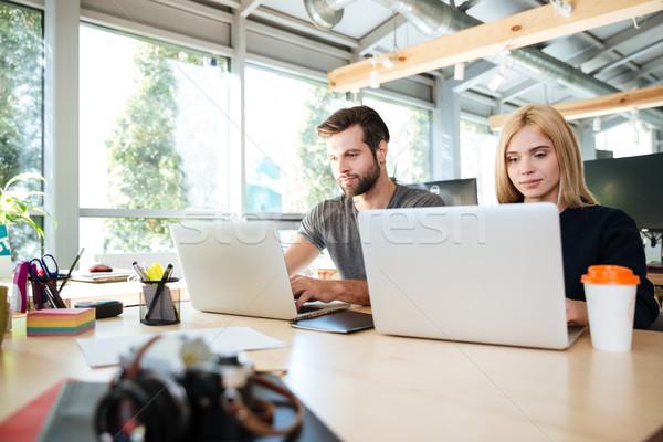 Koncentrált fiatal kollégák ül iroda kép Stock fotó © deandrobot