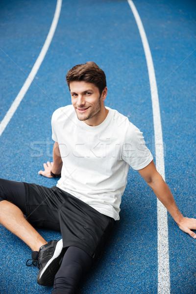 笑みを浮かべて 小さな スポーツ 男 座って スタジアム ストックフォト © deandrobot