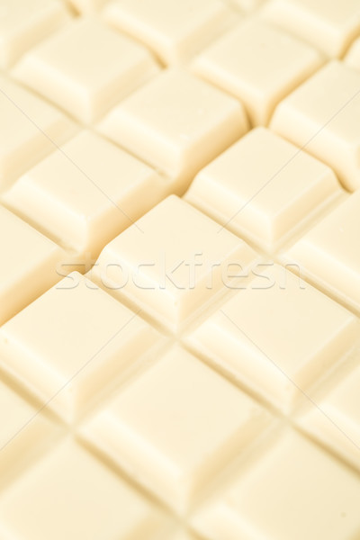 Close-up of white chocolate tiles Stock photo © deandrobot