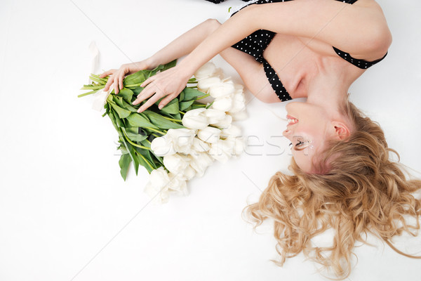 Top view of woman lying on floor with flowers Stock photo © deandrobot