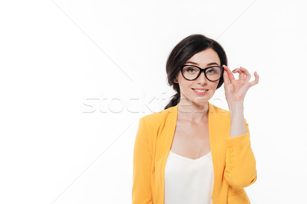 Portrait of a lovely young woman in eyeglasses Stock photo © deandrobot