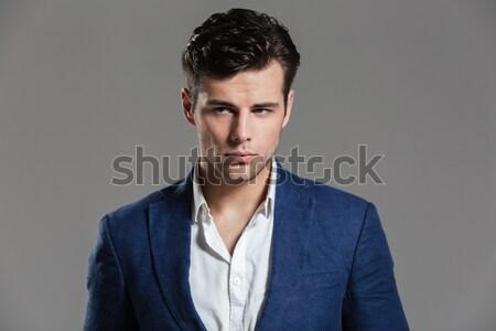 Retrato encantador moço jaqueta posando em pé Foto stock © deandrobot