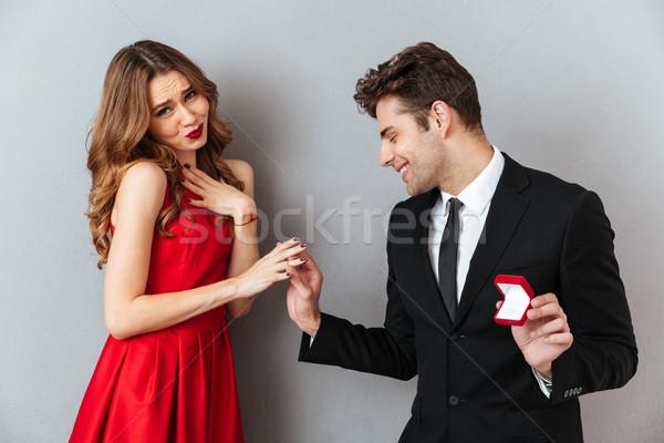 Ritratto eccitato uomo anello di fidanzamento dito Foto d'archivio © deandrobot