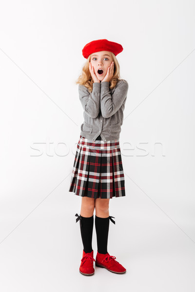 Full length portrait of a shocked little schoolgirl Stock photo © deandrobot