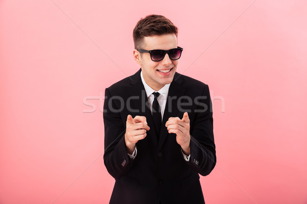 Happy cheerful businessman smiling to aside and smiling isolated Stock photo © deandrobot