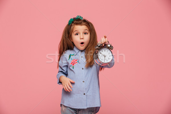 Shot of female kid posing on camera with eyes and mouth wide ope Stock photo © deandrobot