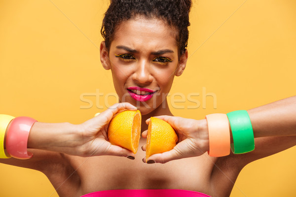 Conceptual photo of stylish mulatto woman with multicolor makeup Stock photo © deandrobot