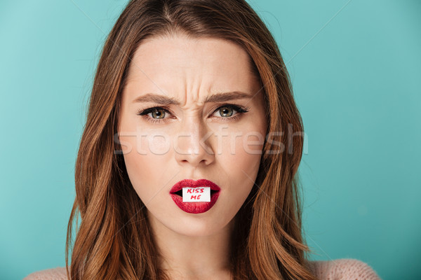Close up portrait of an angry brown haired woman Stock photo © deandrobot